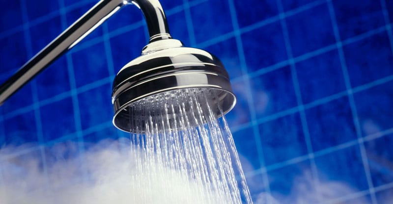 Shower head spraying hot steamy water