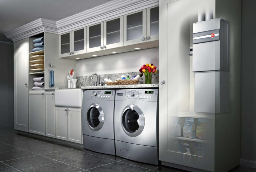 Depiction of a laundry room with modern washer and dryer with a tankless water heater concealed in a cabinet